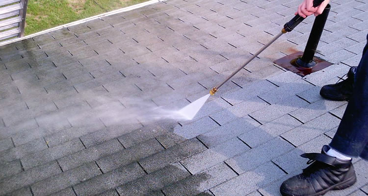 Someone on a roof jet washing it so it doesn't need replacing