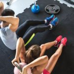 Home gym with man and woman exercising