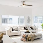 Clean and light room with cream sofas