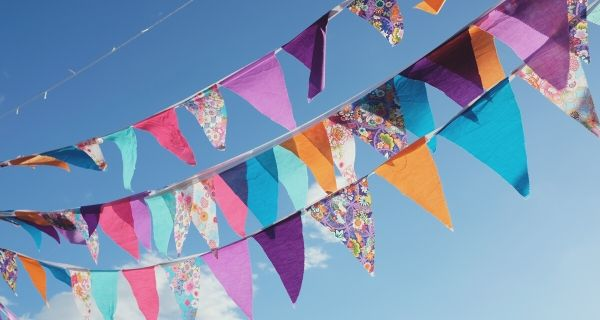colourful bunting blowing in the wind on a blue sky