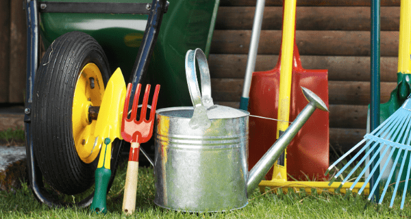 garden tools outside a shed