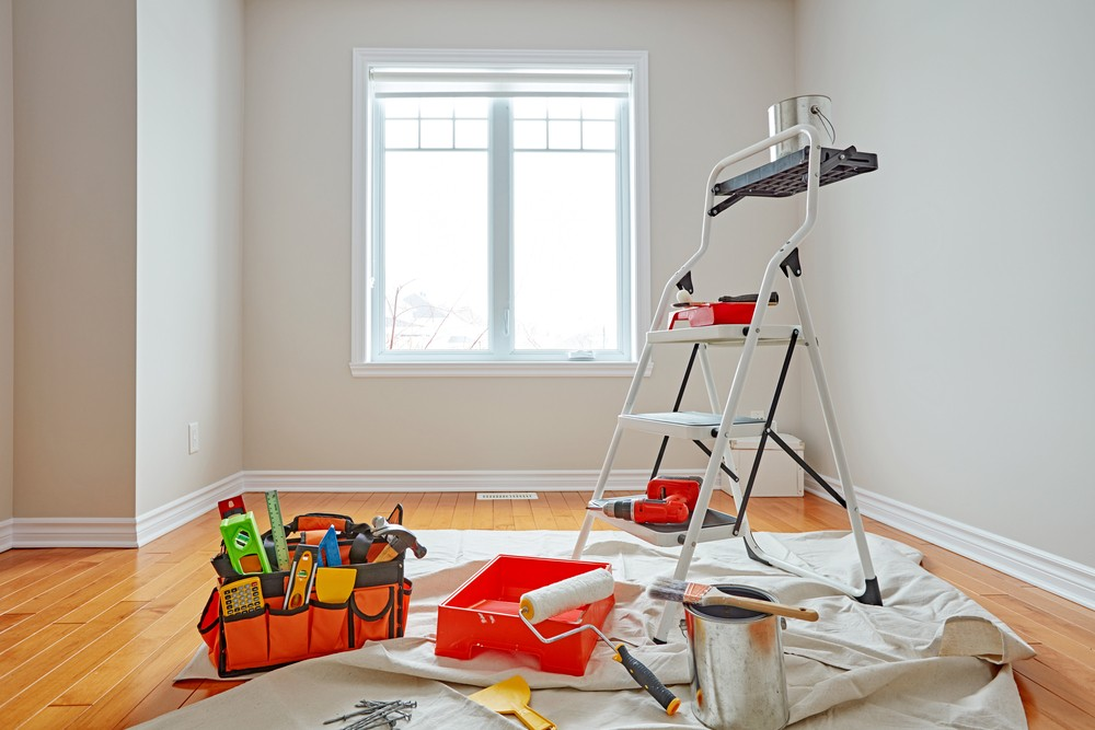 Empty room ready for you to hire a painter. Showing ladder and tools ready to do a professional job.