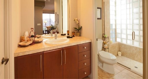 bathroom that has storage under the sink built in as part of a bathroom upgrade