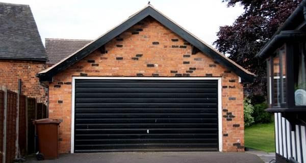 black garage door with pitched roof