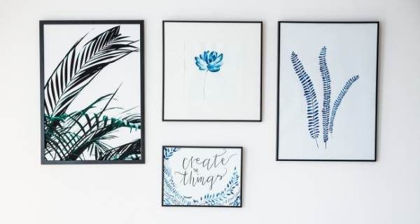Art hanging on a wall that is blue and bold