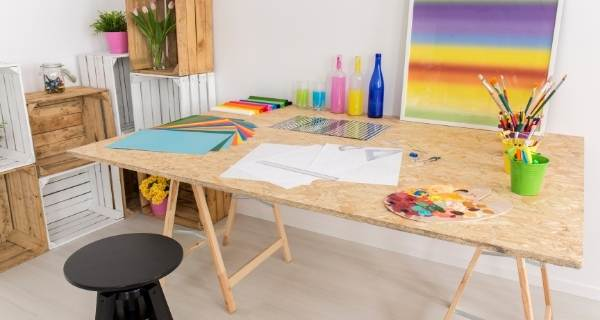 Craft room with art supplies on the table