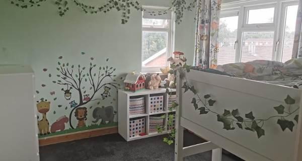 childs bedroom with cartoon animals