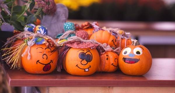 tiny pumpkins with drawn on faces