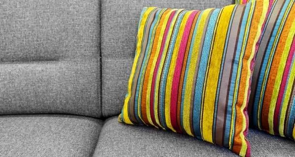 grey sofa and yellow strip cushions