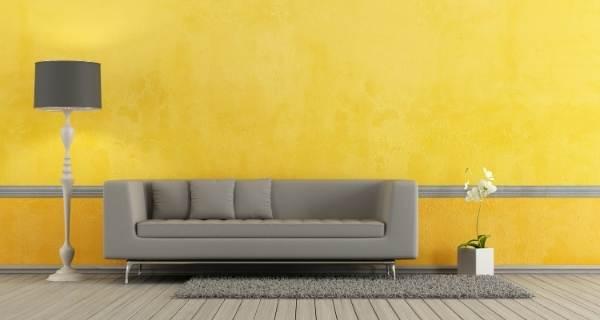 grey sofa with yellow walls
