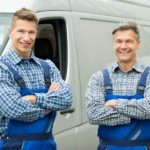 two men outside a van
