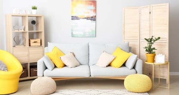 yellow and baby blue sofa art on wall
