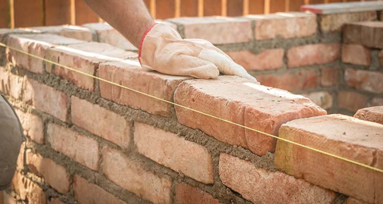 Estimated cost of building a garden wall for Brick home construction costs